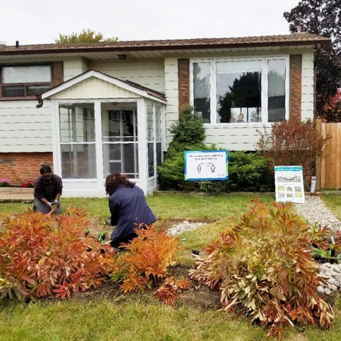 West Bolton SNAP Green Home Makeover homeowners and neighbours plant a pollinator garden