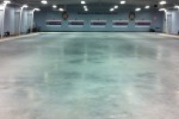 Empty curling rink floor space available for summer usage